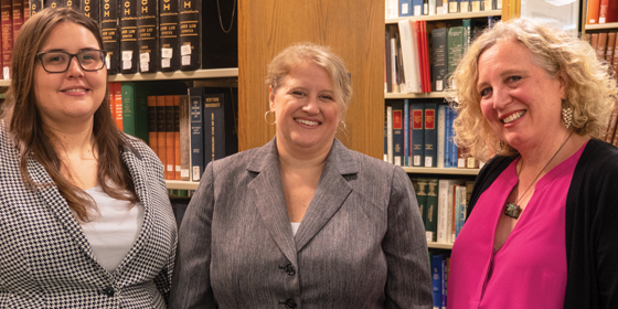 From left, Blair Gerold RLAW'18; Meredith Schalick RLAW'98, a clinical professor at Rutgers Law School in Camden; and Jill Friedman, associate dean for pro bono and public interest programs. Gerold, who is now working as a clerk for New Jersey Supreme Court Justice Jaynee LaVecchia, was a student in Schalick's Expungement Law course in May 2018 that helped low-income residents with the legal procedures to remove past arrests and convictions records.